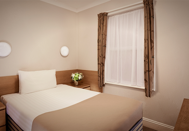 double bed and window hotel room