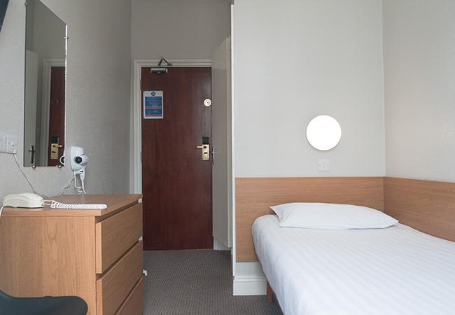 budget hotel single room door view